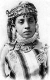 Photo in the tradition of Lehnert & Landrock: Rudolf Franz Lehnert (Czech) and Ernst Heinrich Landrock (German) had a photographic company based in Tunis, Cairo and Leipzig before World War II. They specialised in somewhat risque Orientalist images of young Arab and Bedouin women, often dancers.